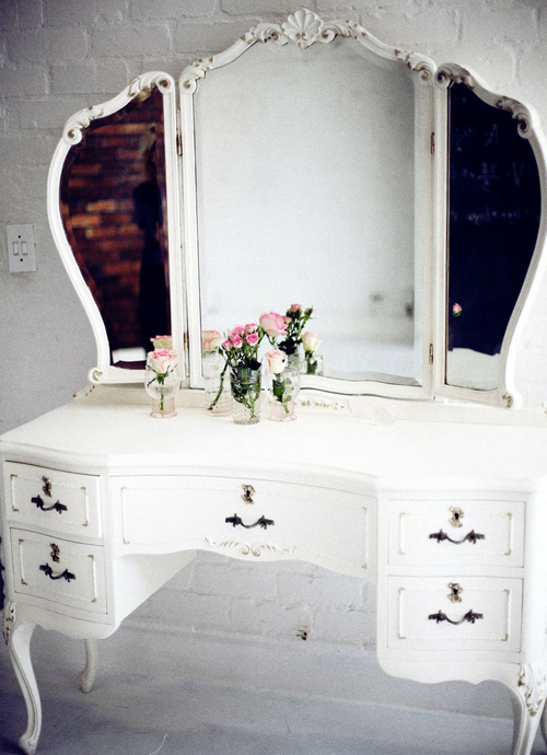 This is much more modern and usually I wouldn't be so keen but I adore the huge mirror with the unusual shape. Lots of storage and a crisp clean white colour.